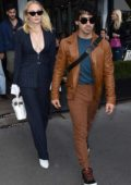 Sophie Turner seen wearing a blue pinstriped suit as she and Joe Jonas leaves L`Avenue restaurant in Paris, France