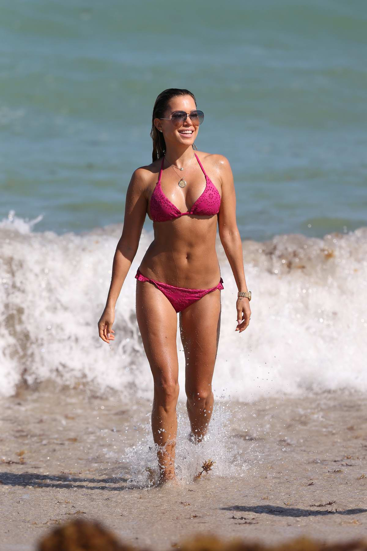 Sylvie Meis sports a pink bikini as she spends a day at the beach in Miami, Florida