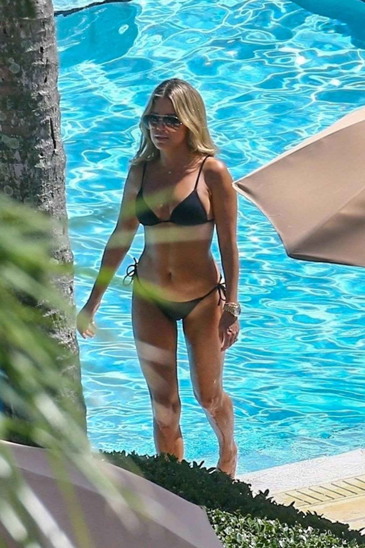 Sylvie Meis spotted in a black bikini by the poolside in Miami, Florida