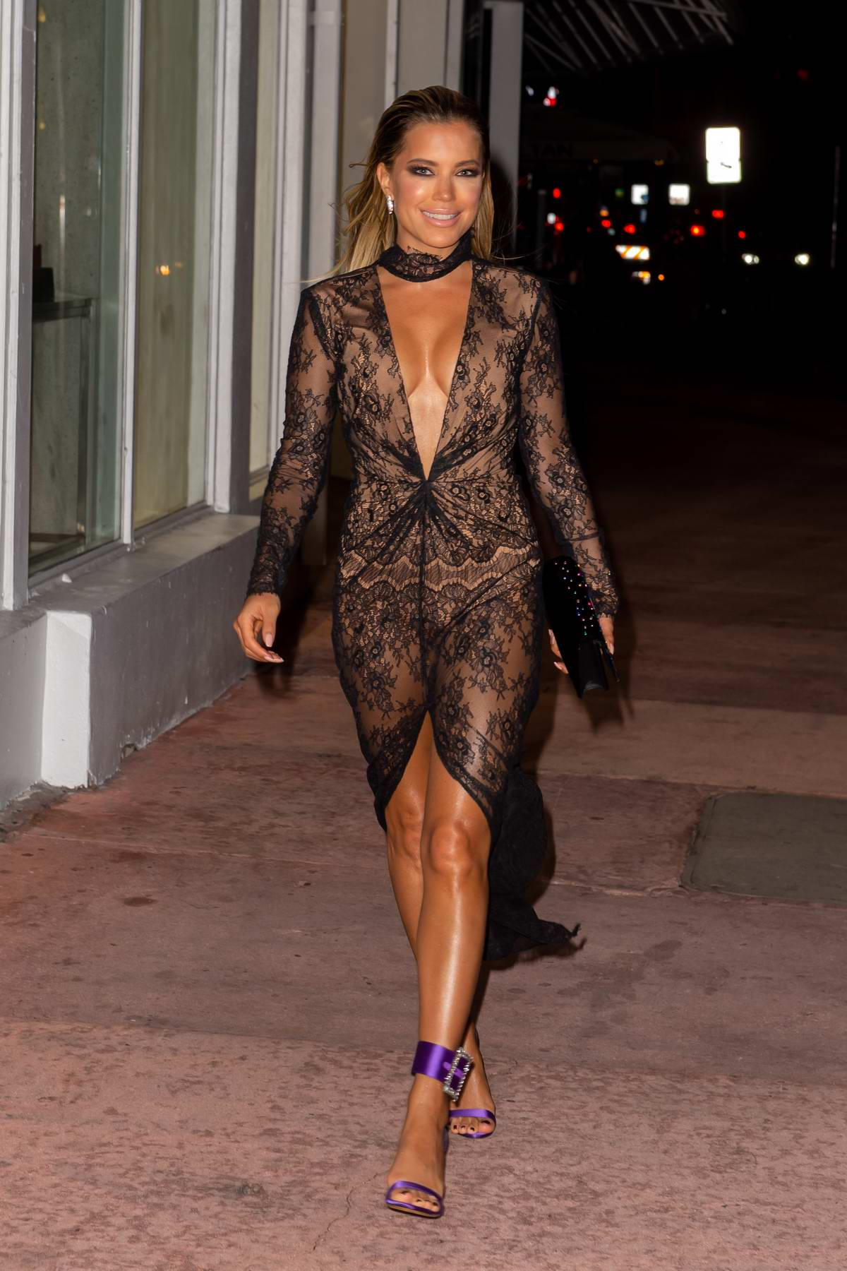 Sylvie Meis wearing a sheer low cut dress as she heads out to dinner in Miami Beach, Florida