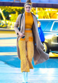 Taylor Hill looks vivacious in a yellow ensemble paired with white boots while out in New York City