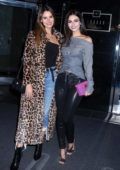Victoria Justice and Madison Reed pose for photos as they leave their hotel in New York City