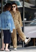 Zoey Deutch seen wearing a khaki jumpsuit while grabbing coffee with a friend at Joan's on Third in Studio City, Los Angeles
