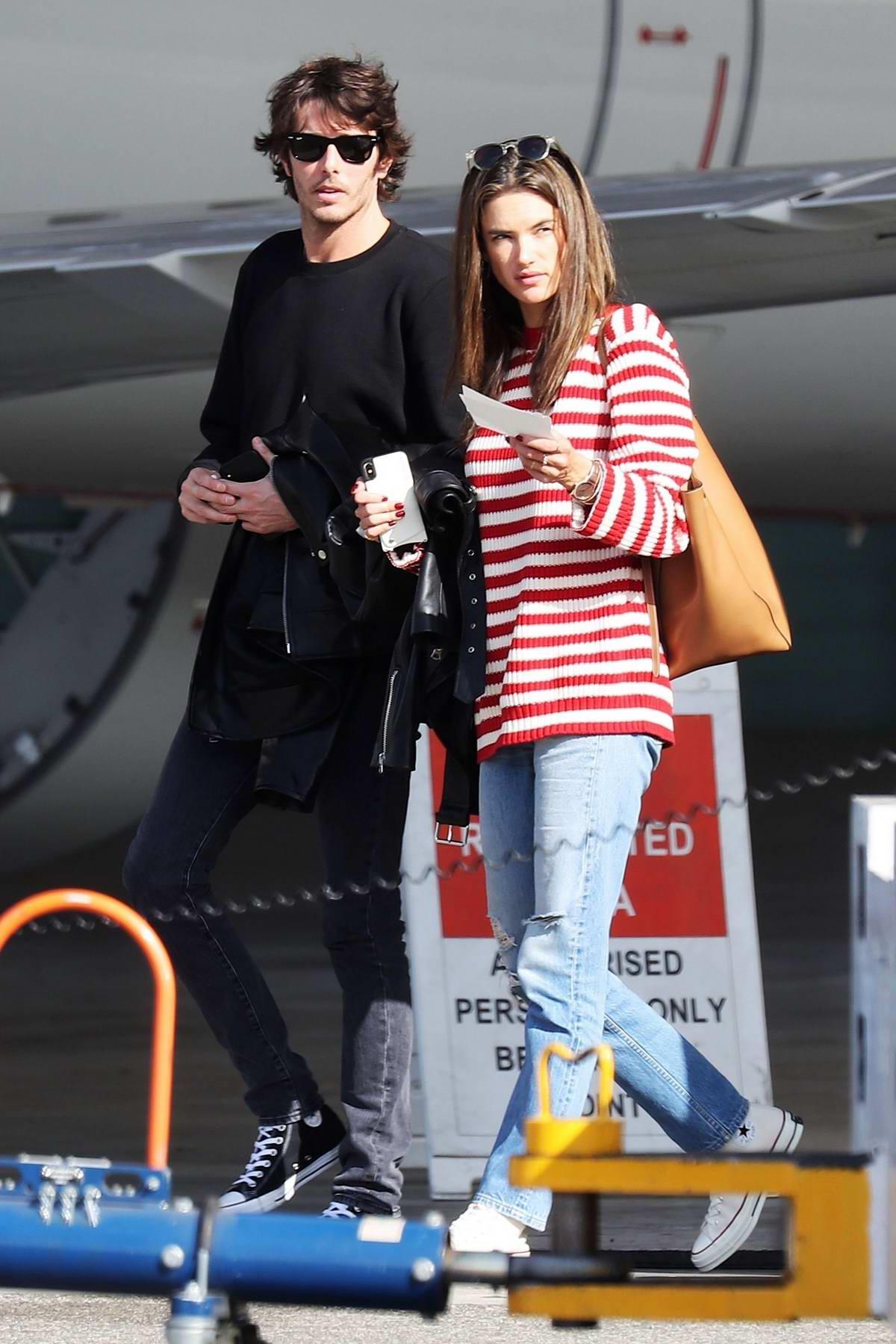 Alessandra Ambrosio and Nicolo Oddi arrives to catch a private jet at the airport in Burbank, California
