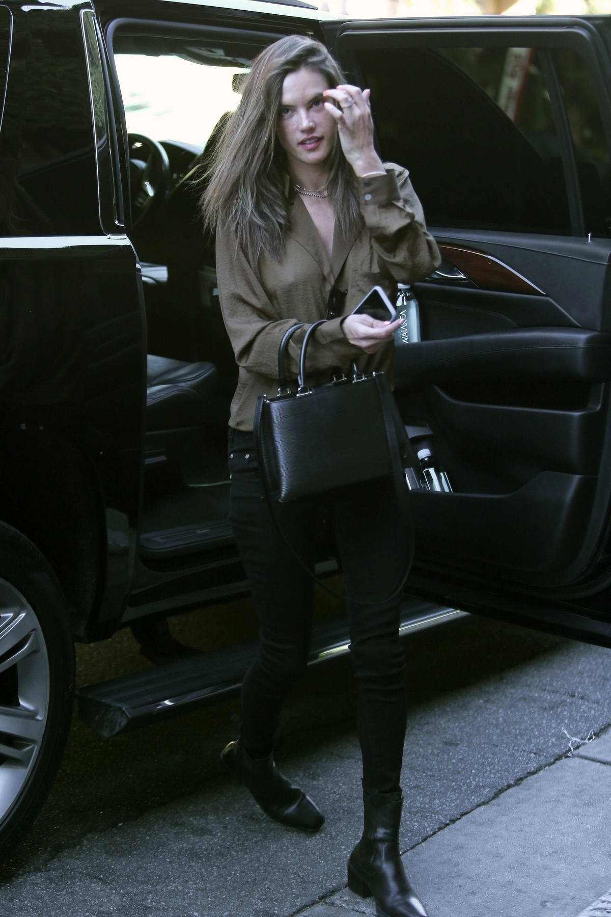 Alessandra Ambrosio is all about business as she heads to a meeting at Petit Ermitage in West Hollywood, Los Angeles