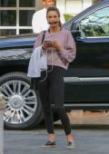 Alessandra Ambrosio looked busy checking her phone while out in Santa Monica, California