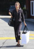 Alessandra Ambrosio looks cool in a brown jumpsuit as she steps for some shopping with her mother Lucilda Ambrosio in Brentwood, Los Angeles