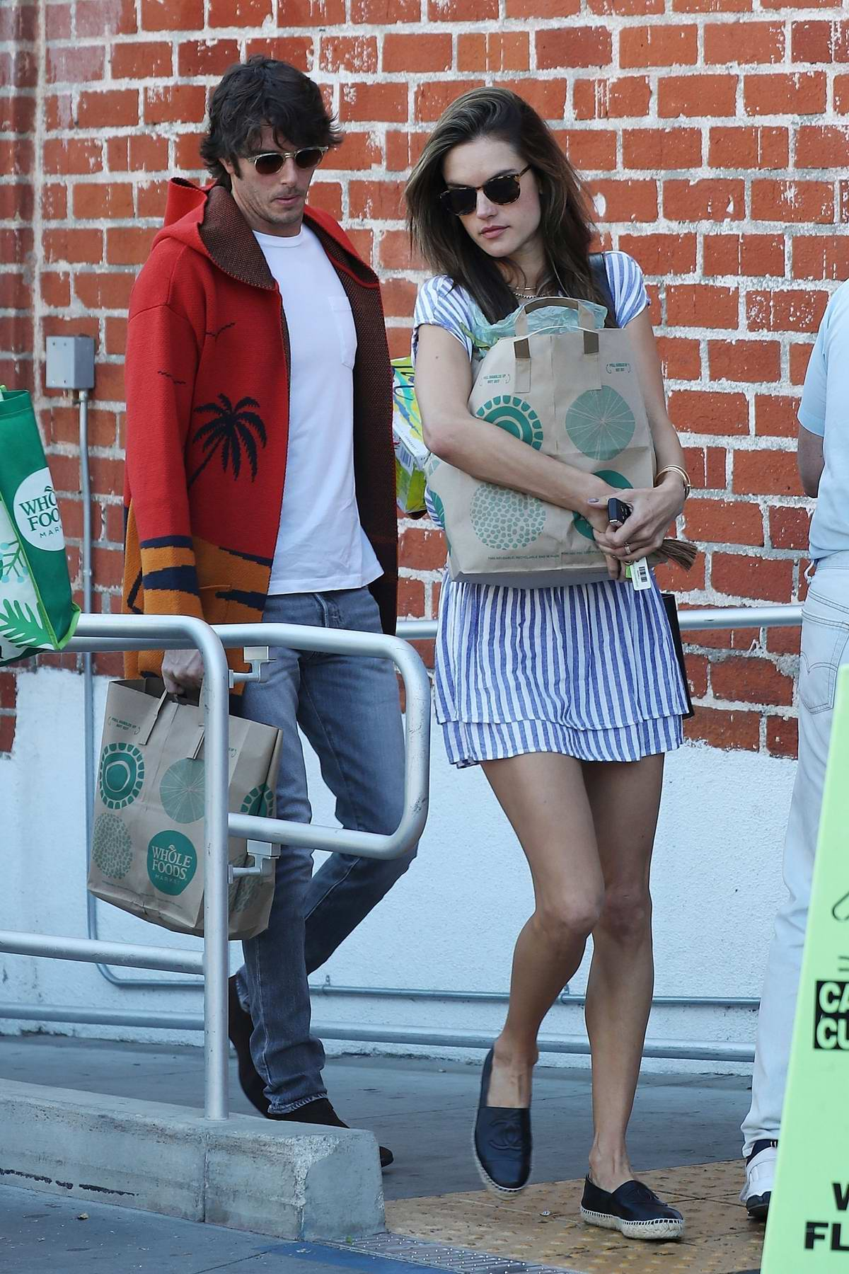 Alessandra Ambrosio looks lovely in a striped short dress while out with boyfriend Nicolo Oddi for some grocery shopping at Whole Foods in Santa Monica, California