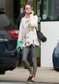 Alessandra Ambrosio seen wearing a knit sweater and sparkly leggings as she leaves her morning yoga class in Los Angeles