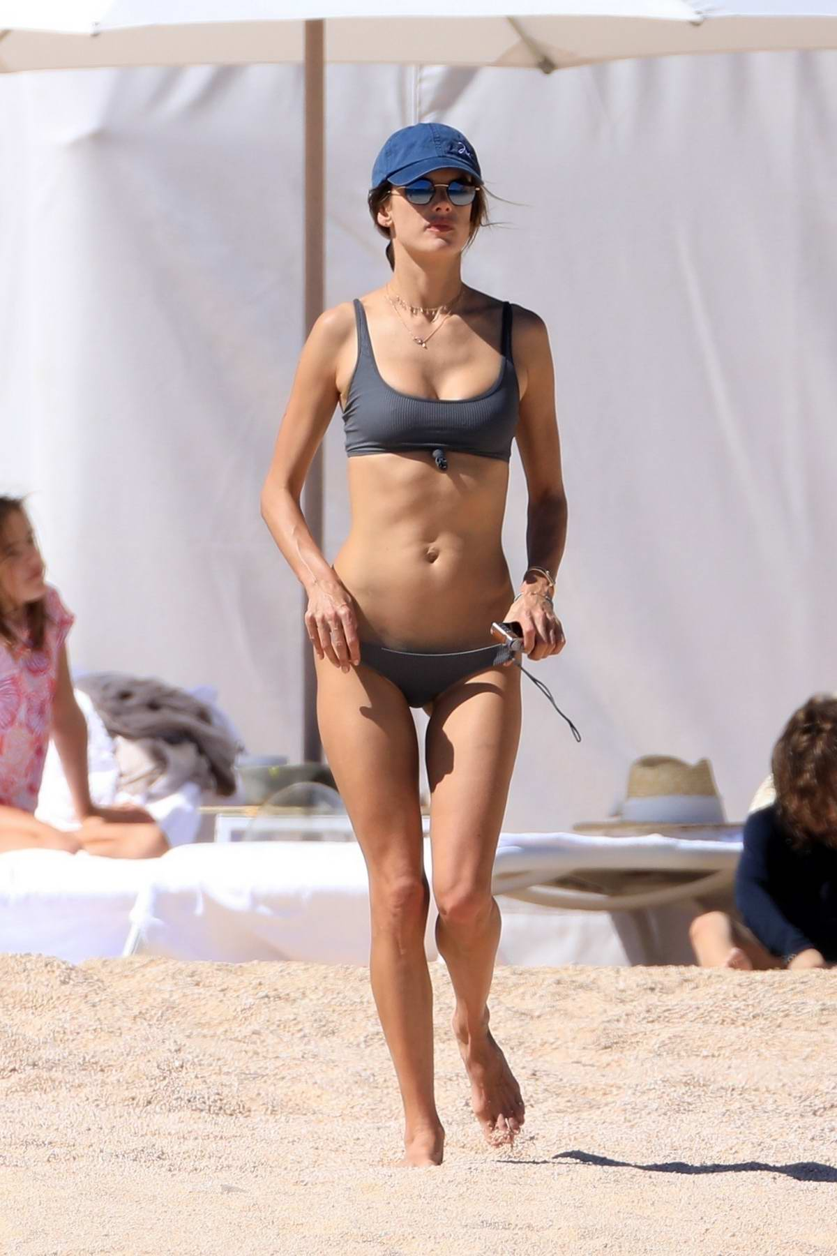 Alessandra Ambrosio shows off her bikini body as she vacations with family in Cabo San Luca, Mexico