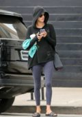 Alessandra Ambrosio sports a black hoodie and blue leggings while out after her morning yoga class in Santa Monica, California