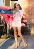 Alessandra Ambrosio sports a retro look in a short pink dress during a photoshoot in Los Angeles