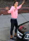 Alessandra Ambrosio steps out make-up free in a pink sweatshirt and black leggings to pick up her kids from a Halloween Party in Santa Monica, California