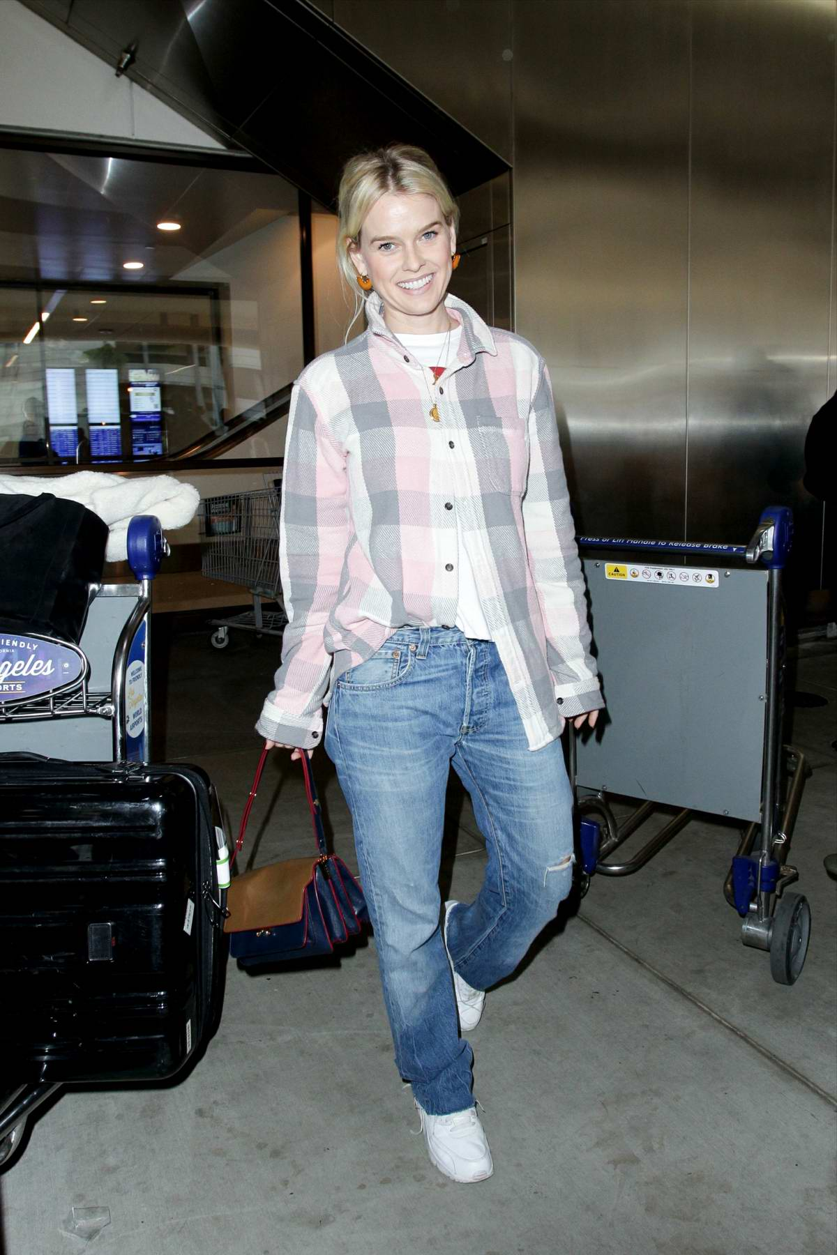 Alice Eve is all smiles as she touch down at LAX airport in Los Angeles