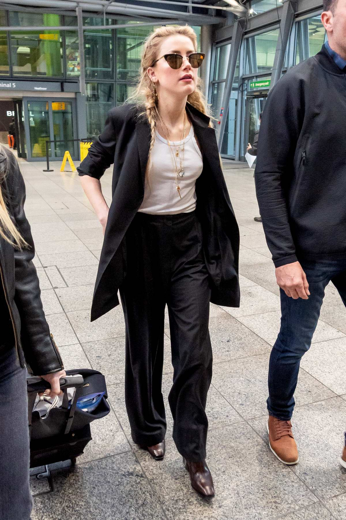 Amber Heard arrives at Heathrow airport to attend the premiere of her new movie 'Aquaman' in London, UK