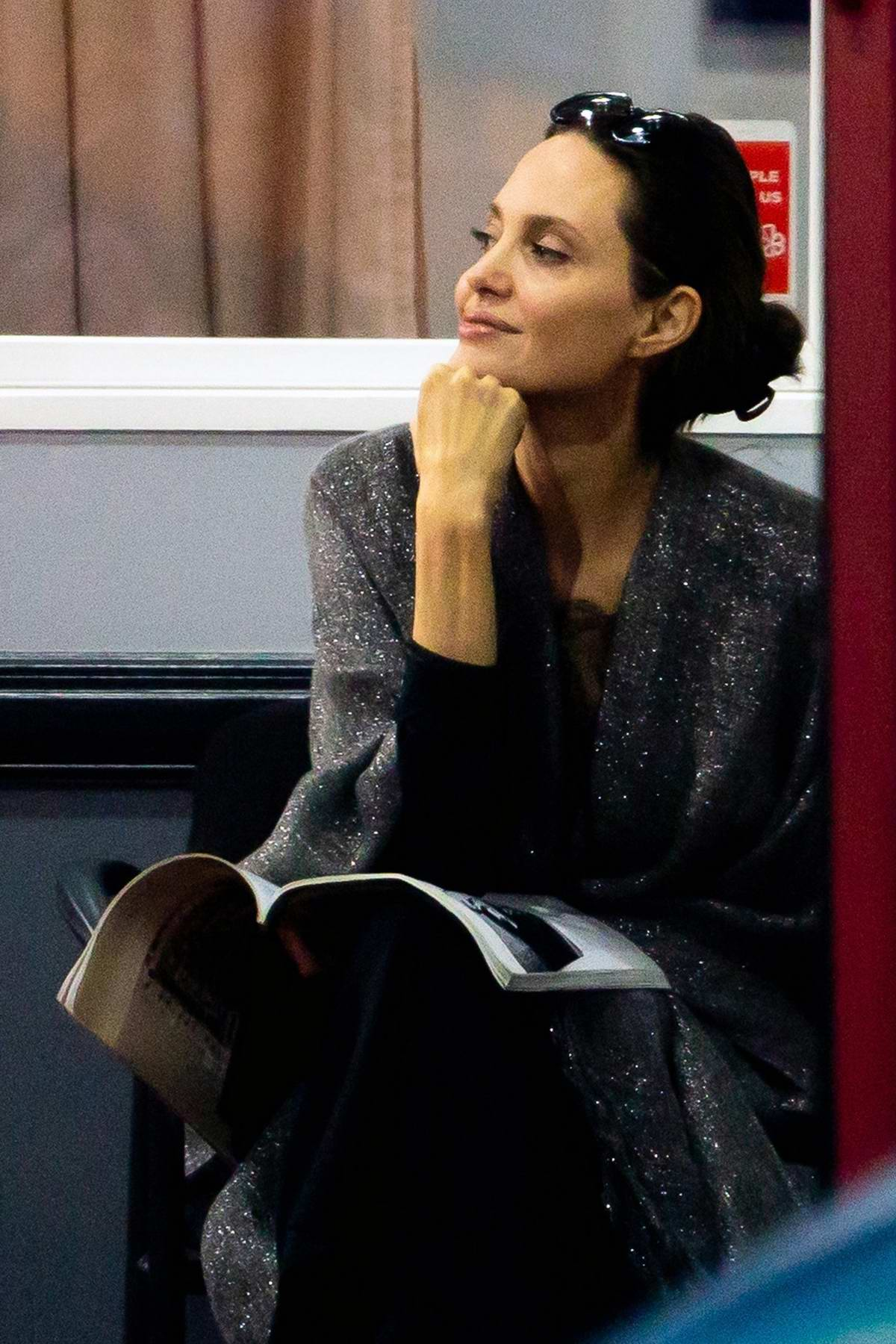 Angelina Jolie happily watches her kids karate class while waiting with other parents in Los Angeles