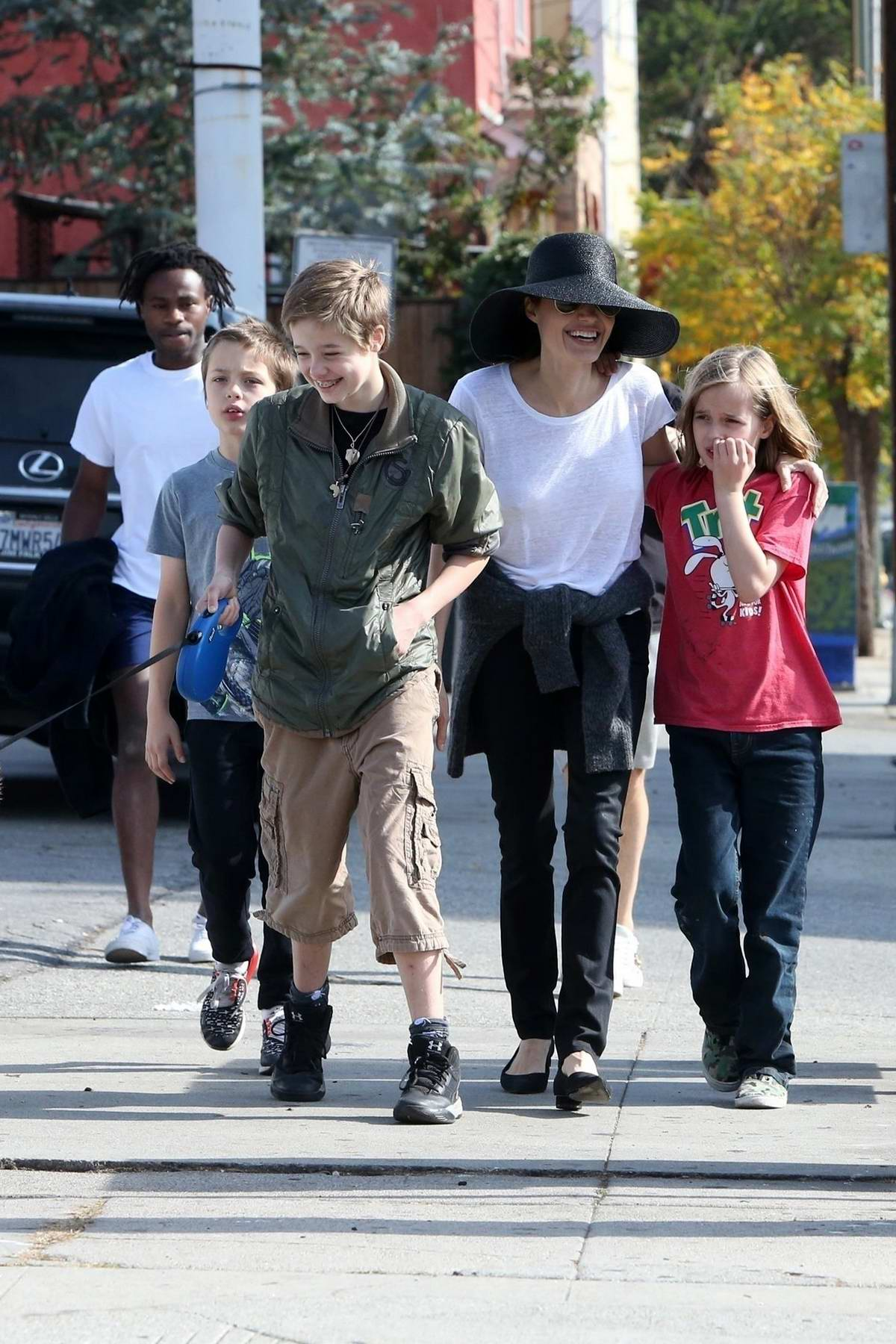 Angelina Jolie looked cheery as she takes her kids to lunch in Los Angeles
