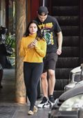 Ariel Winter spotted in a mustard yellow sweater paired with black leggings and leopard print loafers while out for lunch in Los Angeles