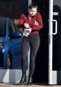 Ariel Winter wears a red sweater and black leggings as she stops by Gray Studios in North Hollywood, California