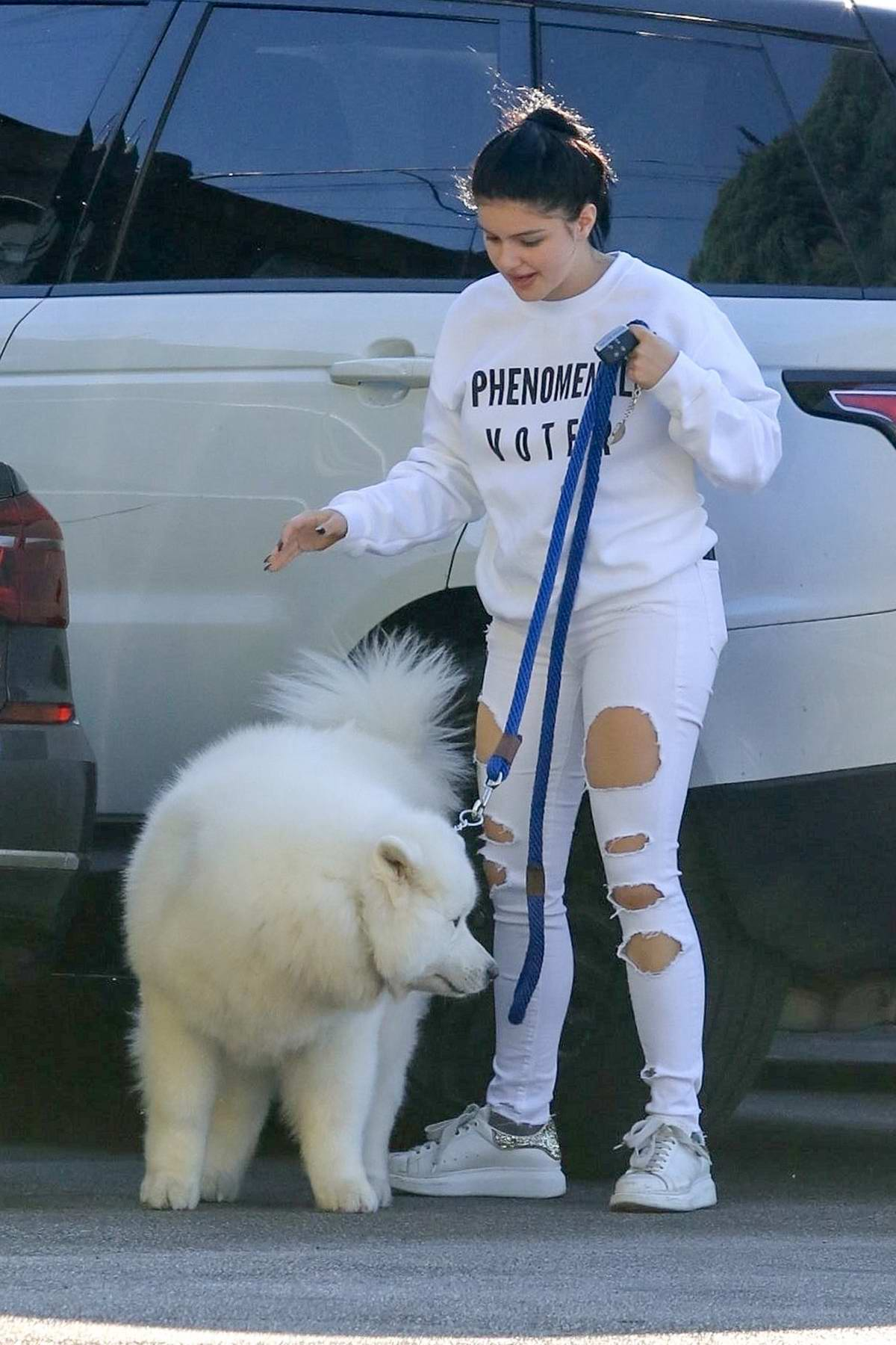 Ariel Winter wears white 'Phenomenal Voter' sweater with a pair of ripped white jeans while visiting Vet's office with her dog in Studio City, Los Angeles