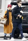 Ashley Tisdale and Christopher French try to stay warm during a day of shopping in New York City