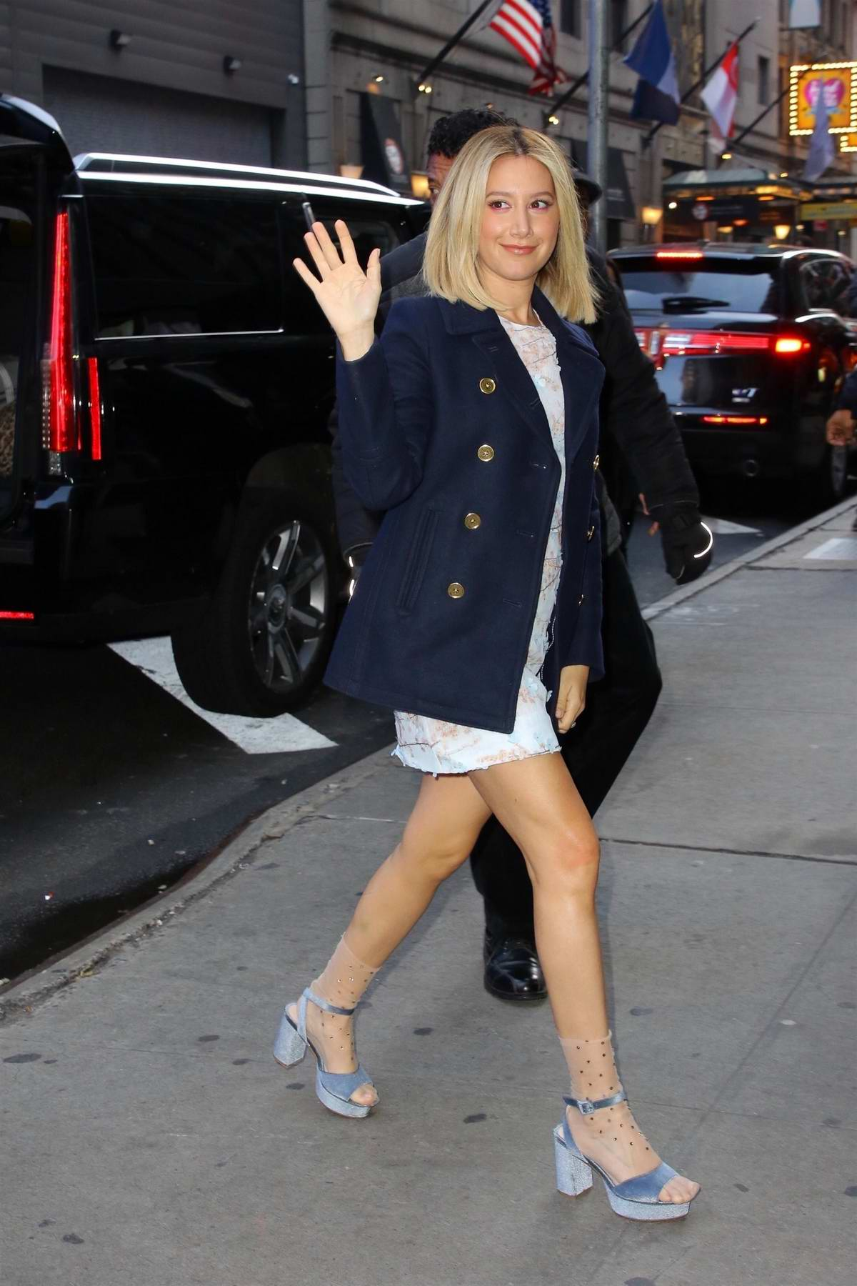 Ashley Tisdale waves for the camera as she arrives at the 'Good Morning America' show in New York City