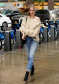 Barbara Palvin looks stunning in a cream sweater with rolled up jeans and black boots while visiting Victoria's Secret offices in New York City
