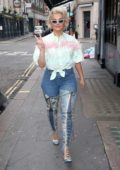 Bebe Rexha smiles for the camera as she steps out in a thigh high laced boots in London, UK