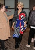 Bebe Rexha wears a Balenciaga robe dress with leather pants as she visits TPMP TV show in Paris, France