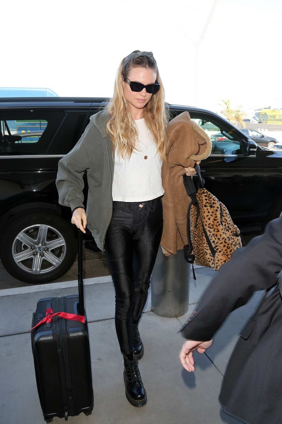 Behati Prinsloo looks stylish as she arrives at LAX airport in Los Angeles