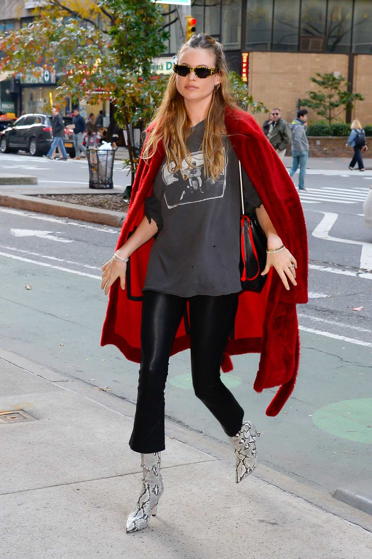 Behati Prinsloo rocks leather pants with snakeskin boots and red fur jacket as she arrives for rehearsals at the Victoria's Secret offices in New York City