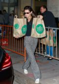 Bella Hadid seen shopping for party supplies and groceries before dropping them off to a friend's place in New York City