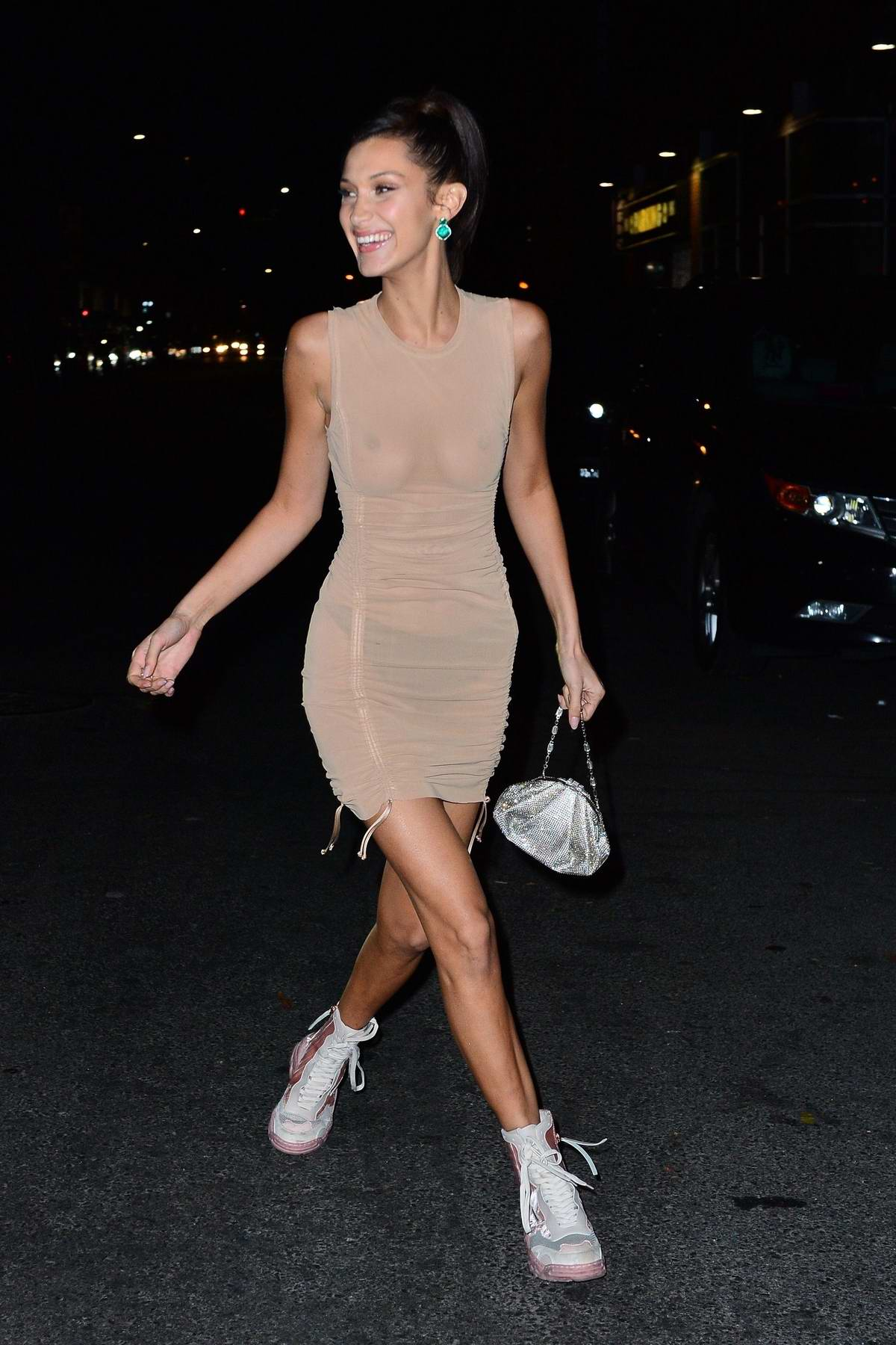 Bella Hadid wears a sheer beige dress while out with The Weeknd after the Victoria's Secret Fashion Show after-party in New York City