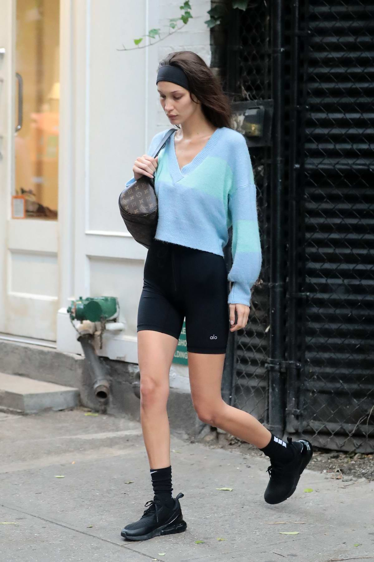 Bella Hadid wore a blue sweater, black biker shorts and Nike trainers as she heads out in New York City