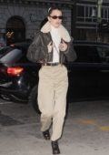 Bella Hadid wore a fur-lined leather jacket with beige pants as she arrives at her apartment in New York City