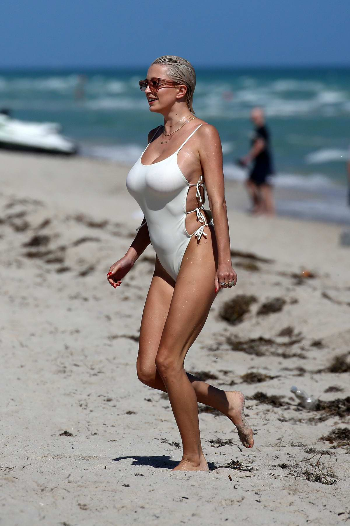 Caroline Vreeland wears a white swimsuit as she hits the beach in Miami, Florida
