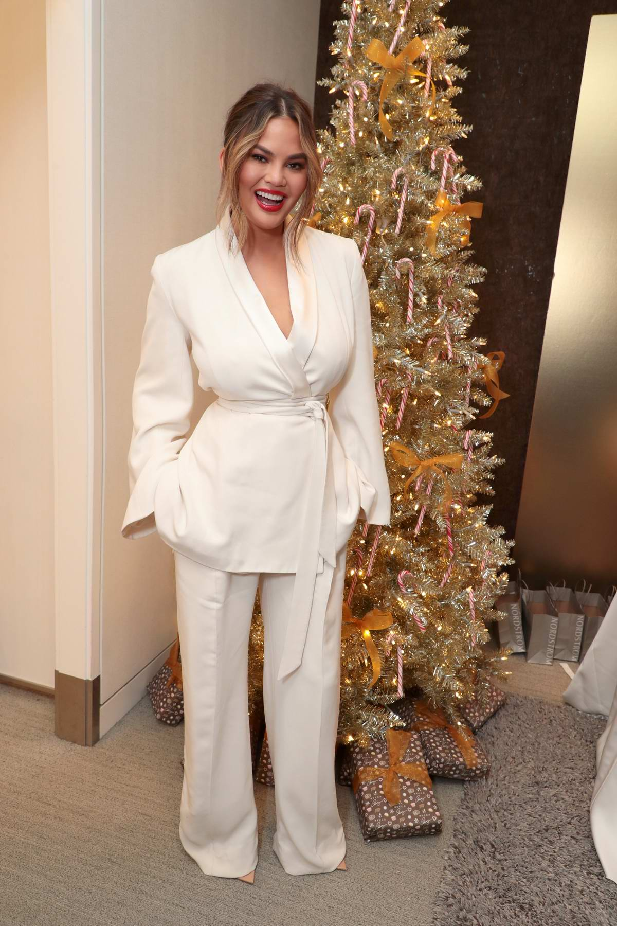 Chrissy Teigen attends launch of her BECCA X Chrissy Cravings Collection in Los Angeles