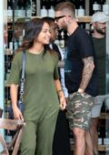 Christina Milian seen wearing a green jumpsuit while out with boyfriend Matt Pokora to pick up some wine in Los Angeles