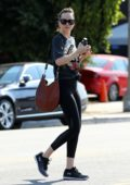 Dakota Johnson looks casual but trendy as she leaves her yoga class after her morning workout in Los Angeles