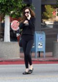 Dakota Johnson looks cute in a black top and leggings as she leaves the gym after a workout in Los Angeles