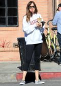 Dakota Johnson picks up an iced coffee while heading to the gym in Los Angeles