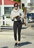Dakota Johnson wears a grey hoodie paired with black leggings as she leaves her Pilates class in Los Angeles