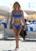 Danielle Knudson wears a blue bikini as she cool off in the ocean on Miami beach, Florida