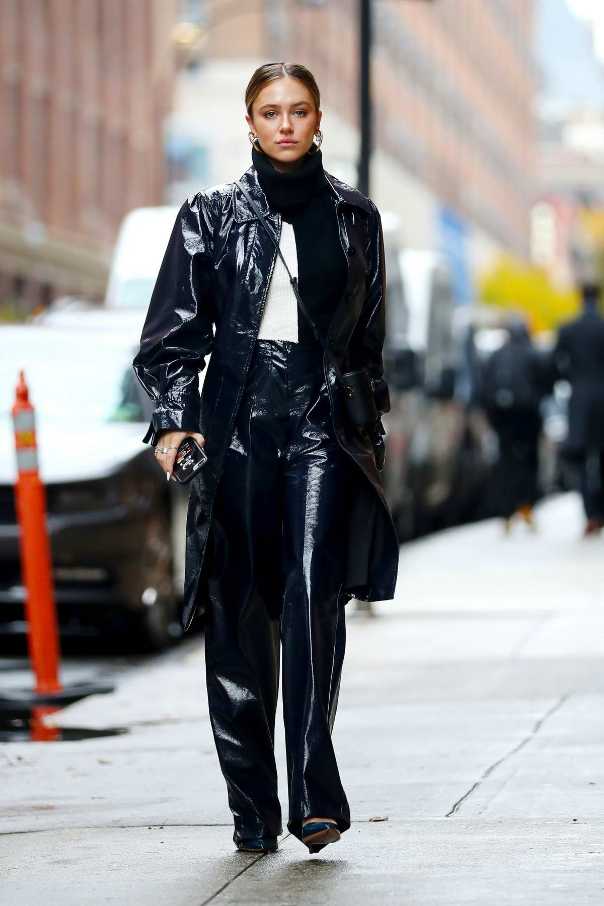 Delilah Hamlin steps out on a rainy day wearing leather trench coat with matching trousers as she heads to a business meeting at Armani in New York City