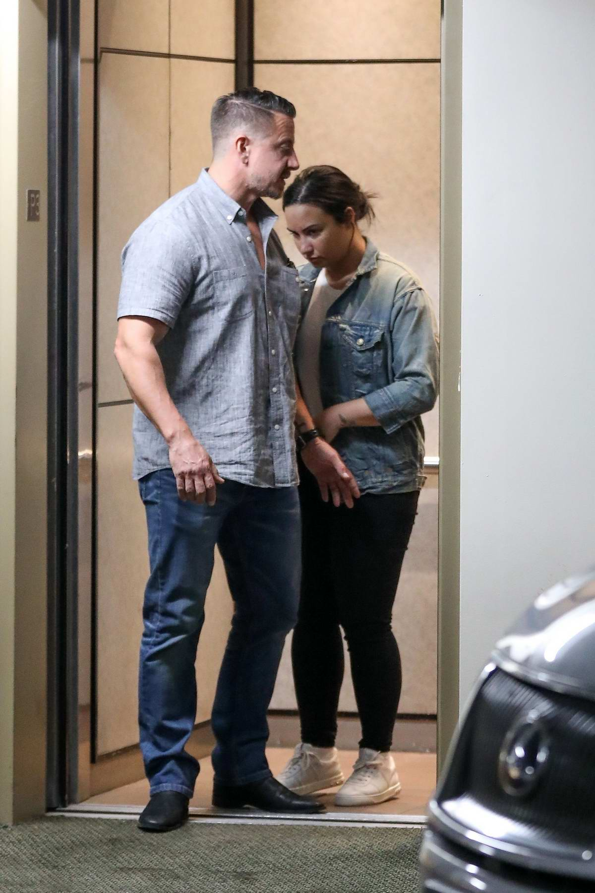 Demi Lovato hides behind her security as she leaves the gym in Beverly Hills, Los Angeles