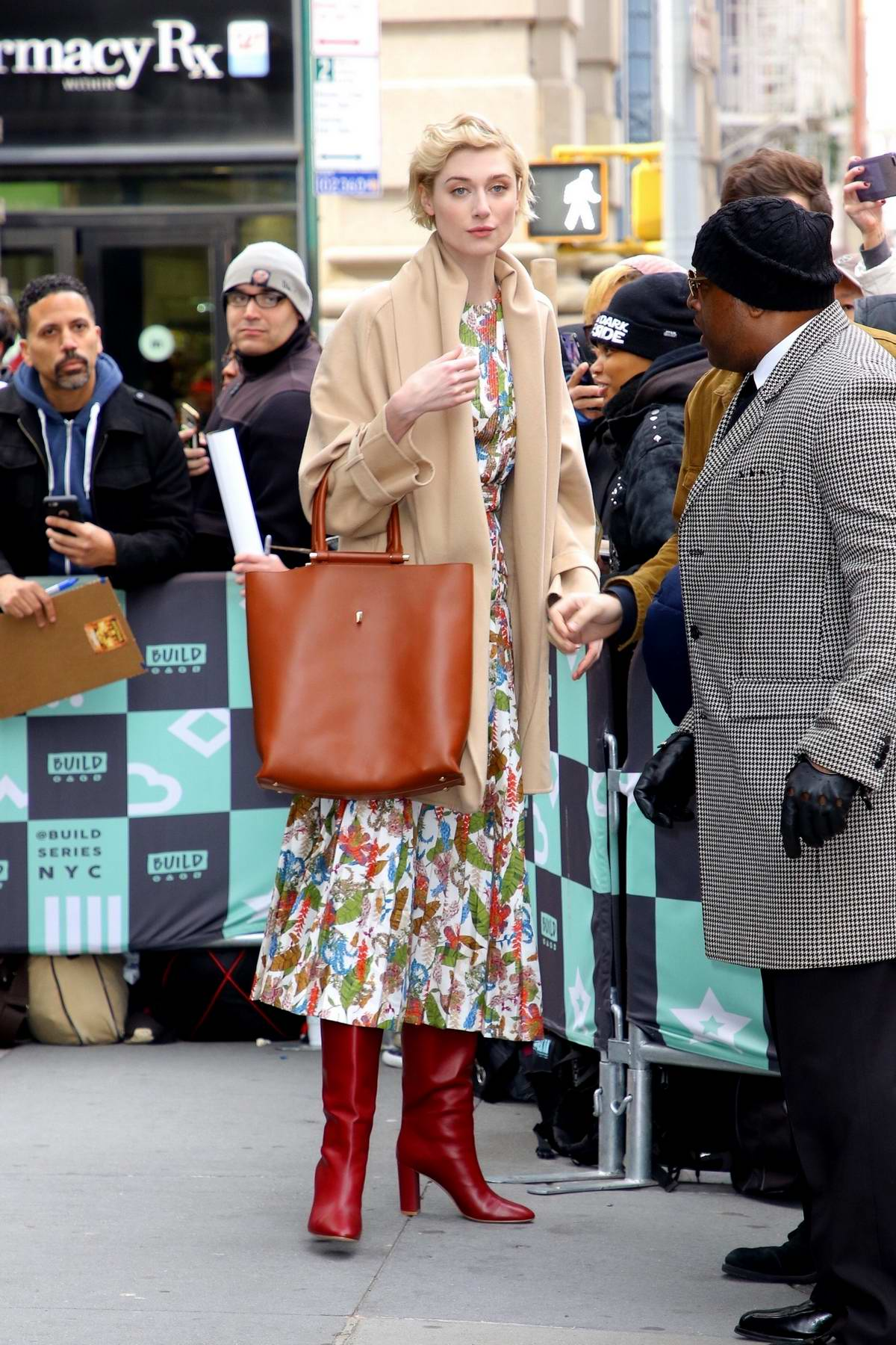 Elizabeth Debicki looks lovely in a floral dress with a pair of red boots as she visits AOL Build Series in New York City
