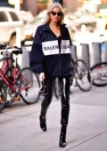 Elsa Hosk rocks Balenciaga windbreaker with black PVC pants while arriving at Victoria's Secret offices in New York City