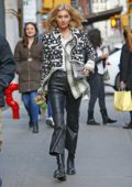 Elsa Hosk steps out in a patterned jacket, leather pants and boots in New York City