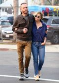 Emilia Clarke and Chalie McDowell keeps their arms wrapped around each other while out grabbing groceries in Venice Beach, California