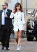 Emily Ratajkowski rocks an all white ensemble with her Raquel Welch hairdo while visiting 'Jimmy Kimmel Live' in Los Angeles